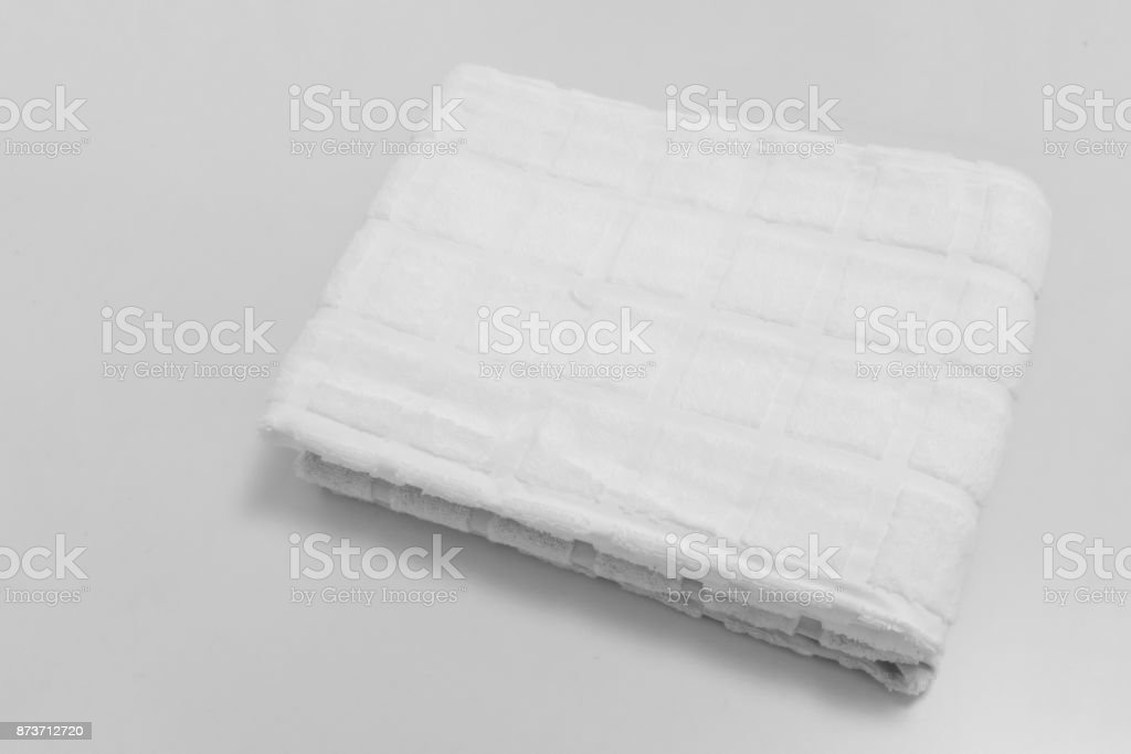 Small folded towels isolated on white background. stock photo