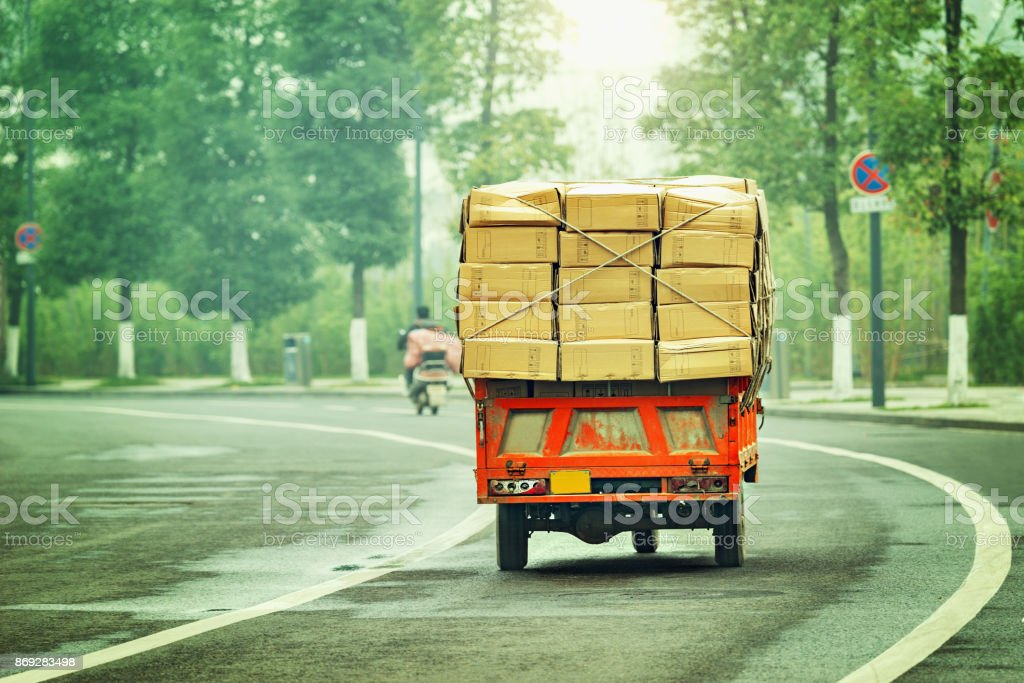 Small freight car with cardboard boxes. stock photo
