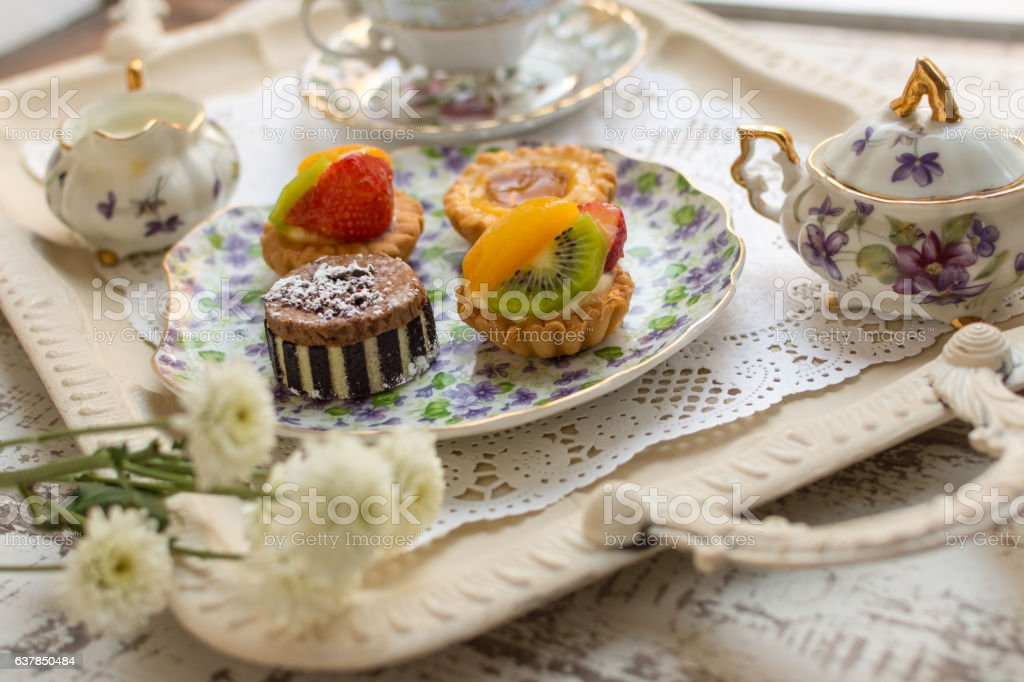 Small fruit tarts laid out on an antique china plate royalty-free stock photo