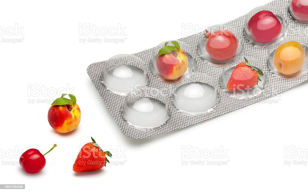 Small fruits in a pill blister packs stock photo
