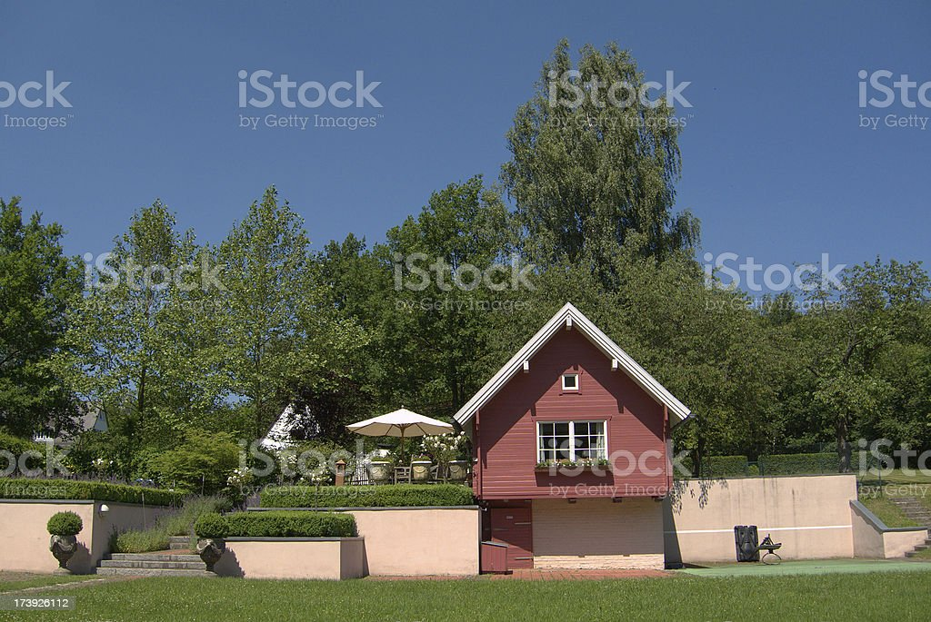 small garden house with meadow royalty-free stock photo