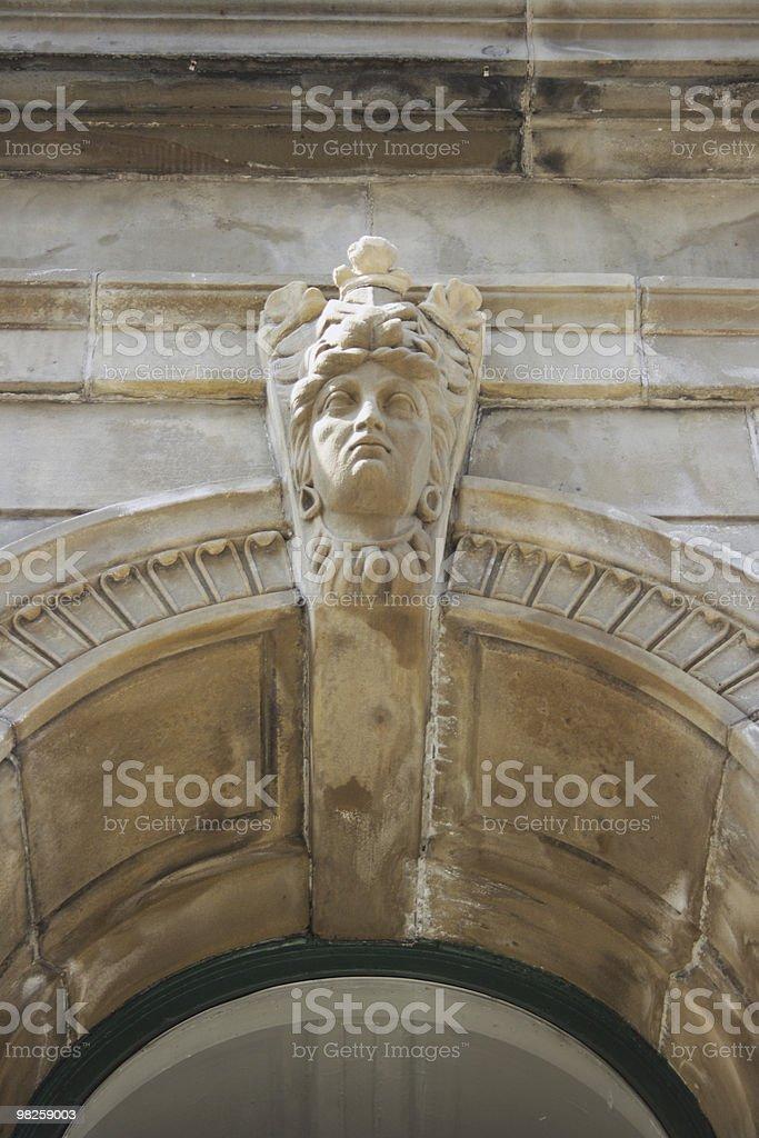 small gargoyle and arch royalty-free stock photo