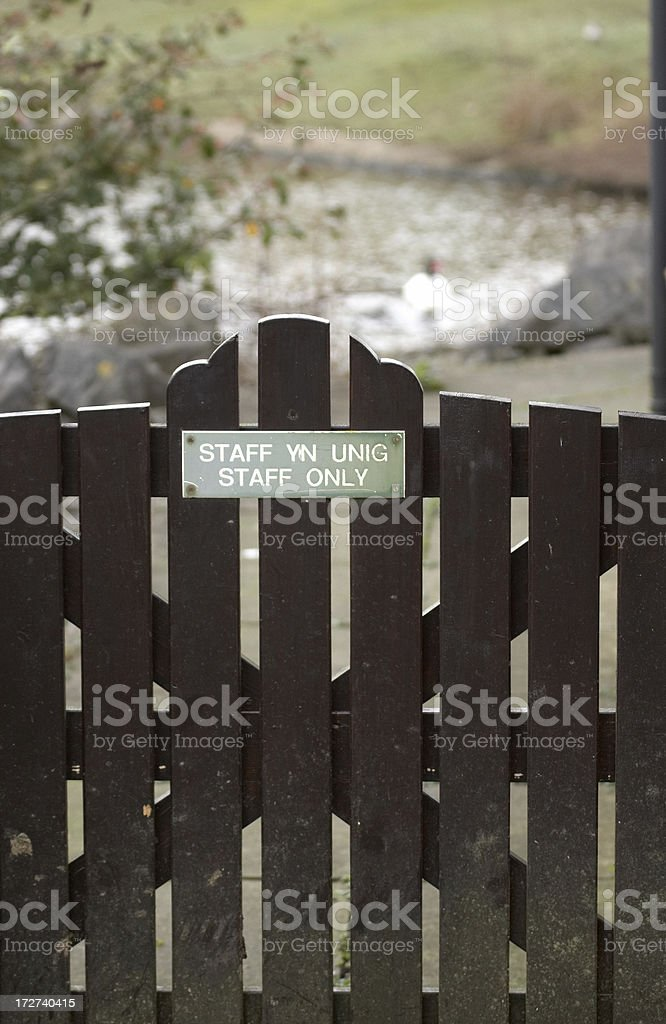 Small gate staff only sign stock photo