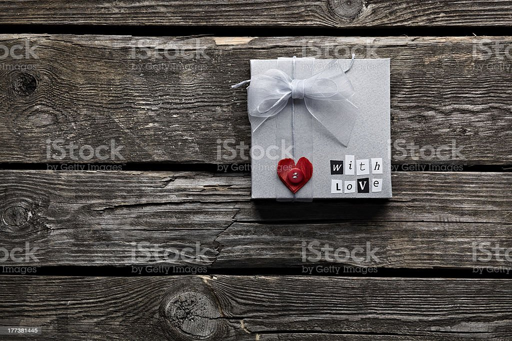 Small gift box on old vintage wooden background. royalty-free stock photo
