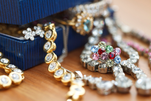 istock Small gift box with costume jewelry spilling out 176125540
