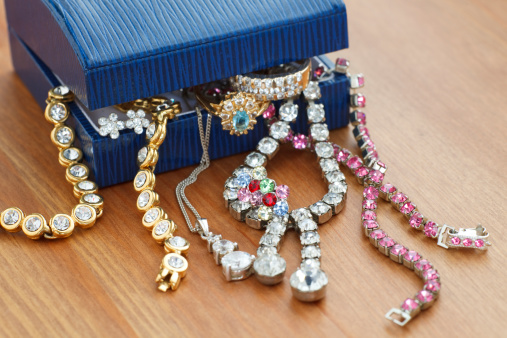 istock Small gift box with costume jewelry spilling out 176130150