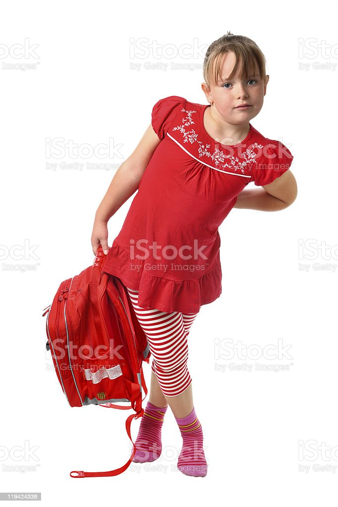 Small girl carrying heavy school bag isolated on white background royalty-free stock photo