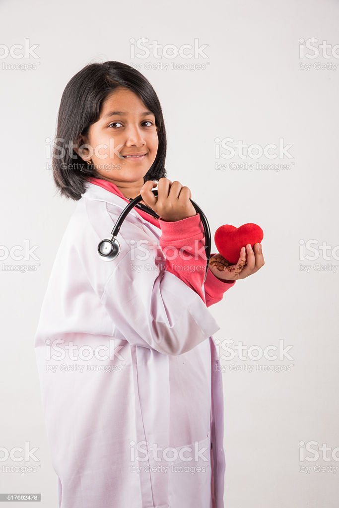 small girl doctor with stuffed heart stock photo