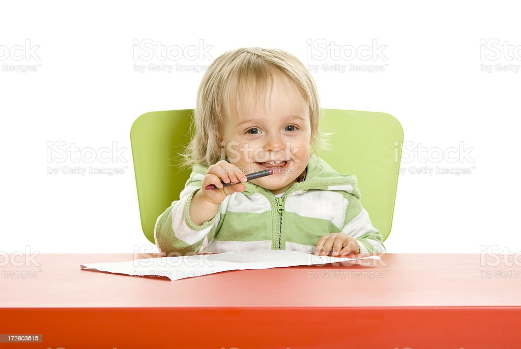 Small girl drawing isolated on white royalty-free stock photo