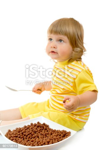 istock Small girl eat corn flakes 92173513