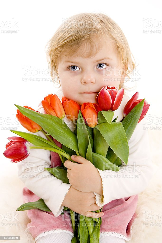 small girl holding bouquet of flowers royalty-free stock photo