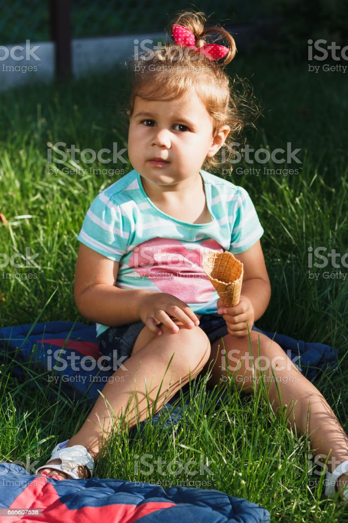 Small girl holds a waffle Cup in the hand royalty-free stock photo