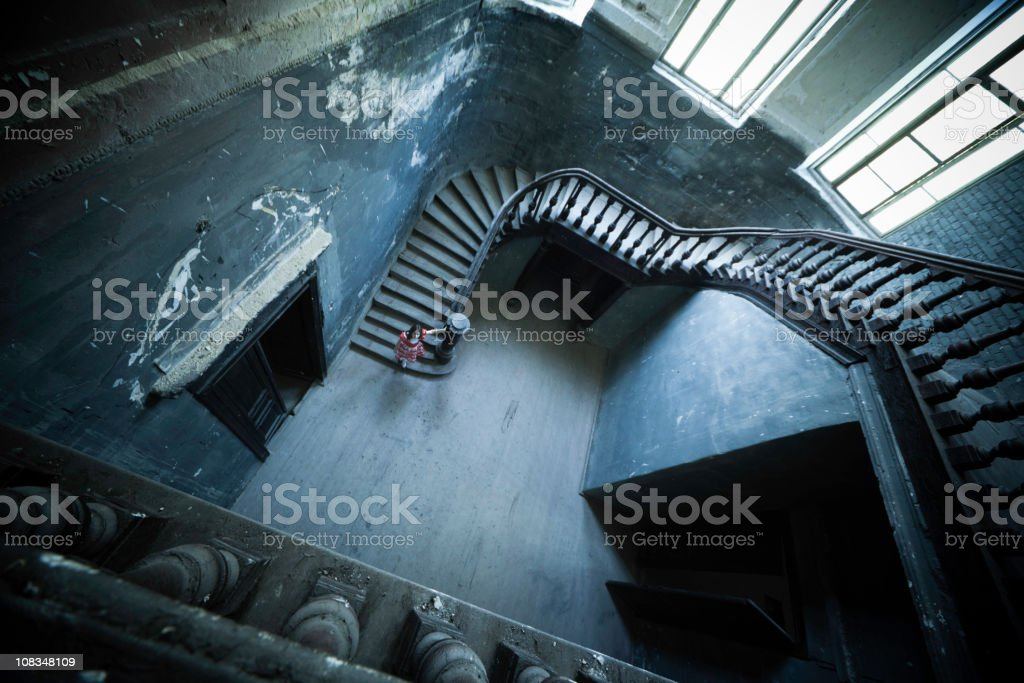 Small Girl in Abandoned Mansion stock photo