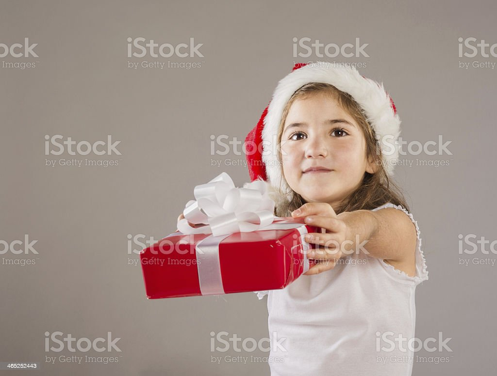 Small Girl In Santa Hat With Christmas Gift Stock Photo & More ...
