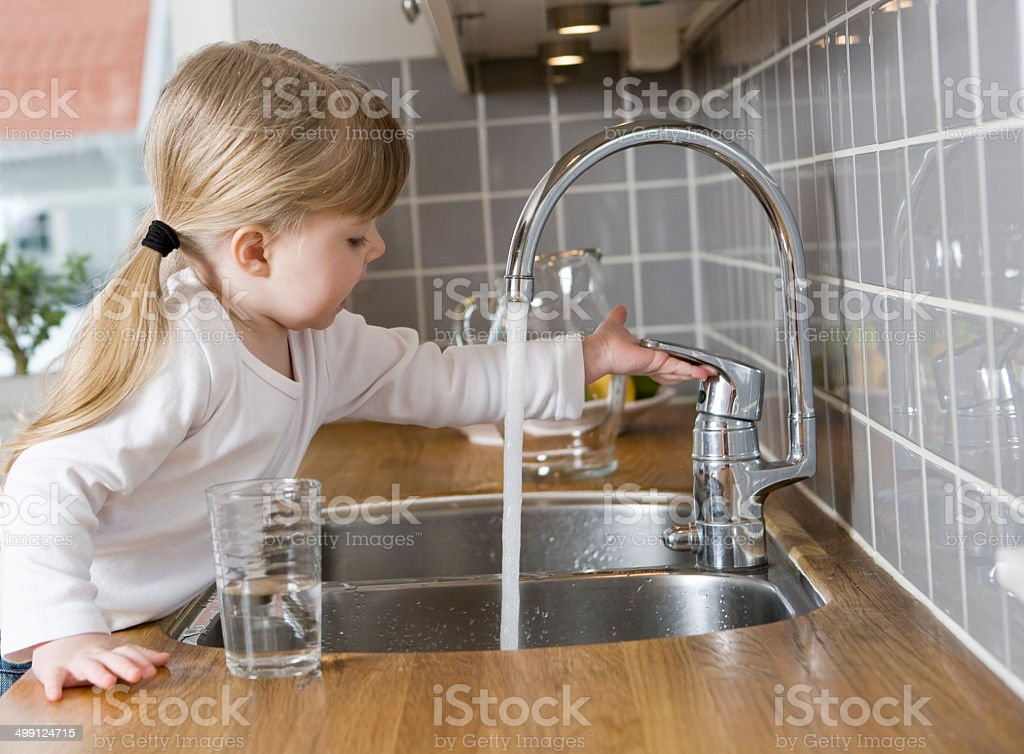 Small Girl in the kitchen stock photo