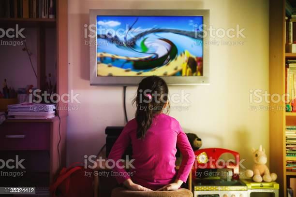 Small girl is watching a cartoon picture id1135324412?b=1&k=6&m=1135324412&s=612x612&h=kvm6gprqenxrwp0awzgr3fsfii5kntdgskmvsiv17fq=