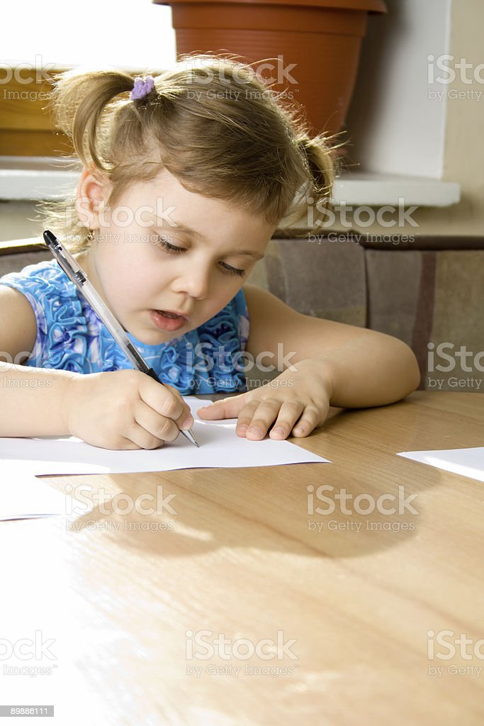small girl learns to write royalty-free stock photo