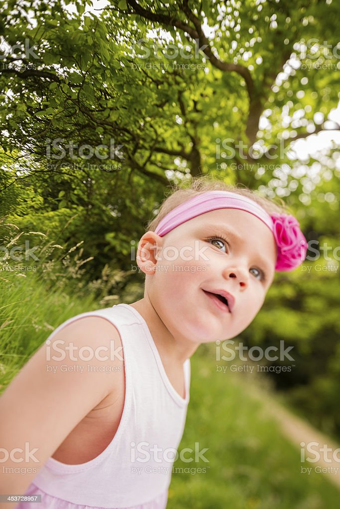 Small girl outdoors smiling royalty-free stock photo