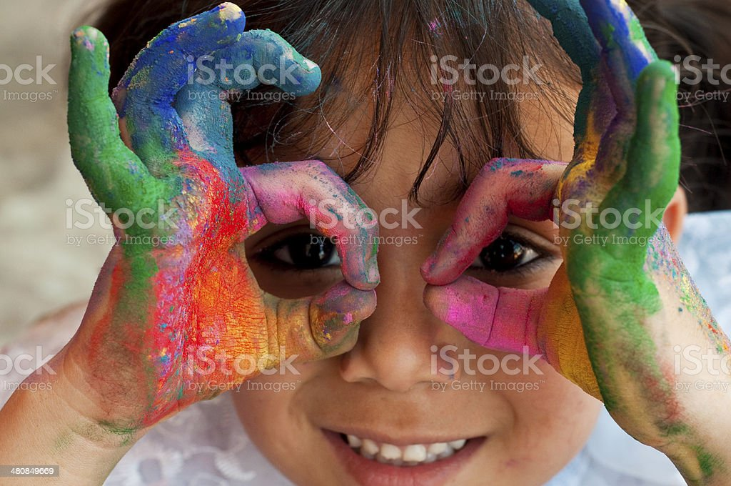 Small girl playing with colors Playing with colors 2-3 Years Stock Photo