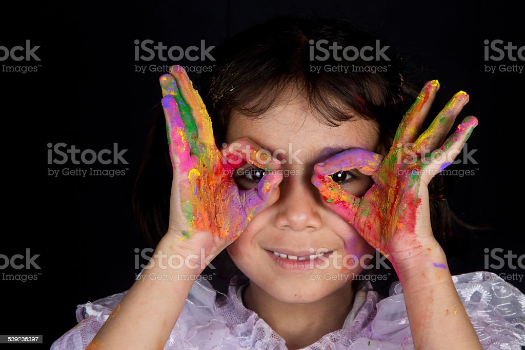 Small girl playing with colors royalty-free stock photo