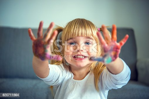 istock Small girl playing with colors 620711564