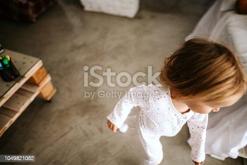 Small girl running in her bedroom