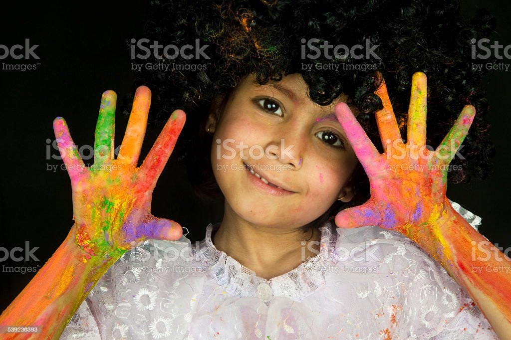 Small girl showing vibrant colored hand and smiling royalty-free stock photo