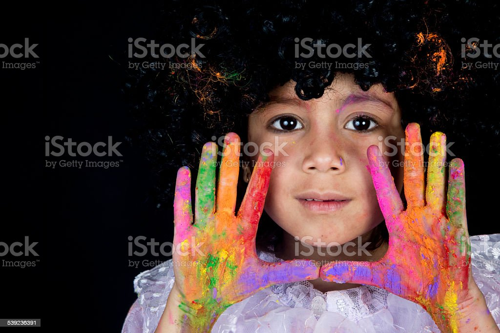 Small girl showing vibrant colored hands and smiling royalty-free stock photo