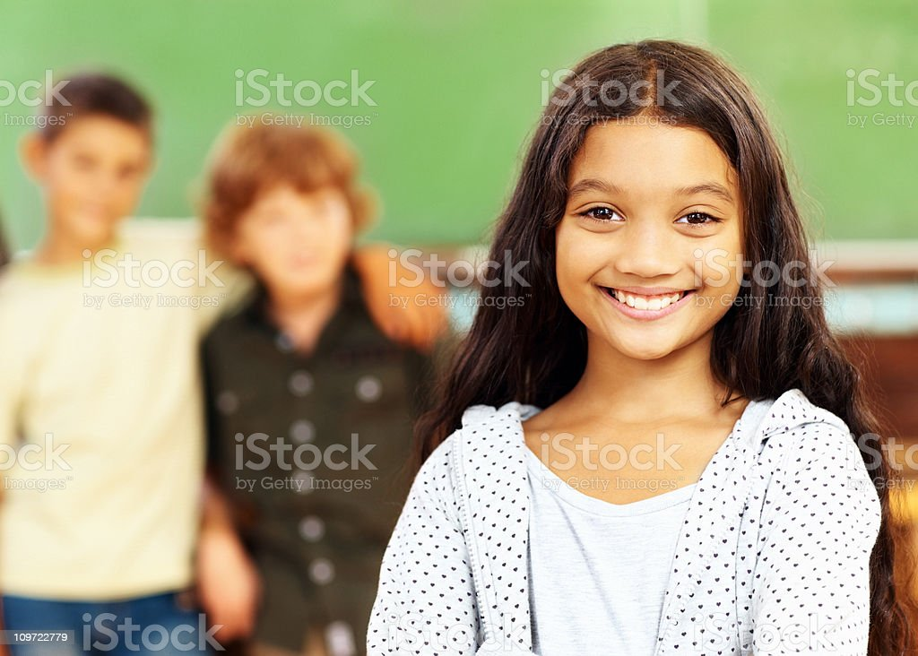 Small girl smiling at her classroom royalty-free stock photo