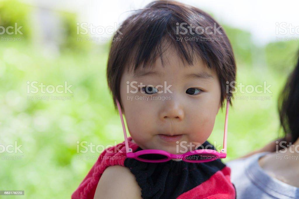Small girl wearing sunglasses stock photo
