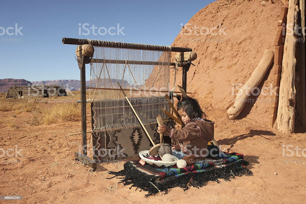 Small Girl Weaving Blanket royalty-free stock photo