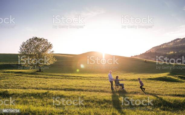 Small girl with her senior grandparents with wheelchair having fun picture id980754734?b=1&k=6&m=980754734&s=612x612&h=qujyo0qxavsara7zkidcwiss9ihtdvsp3eiz3kbfshi=