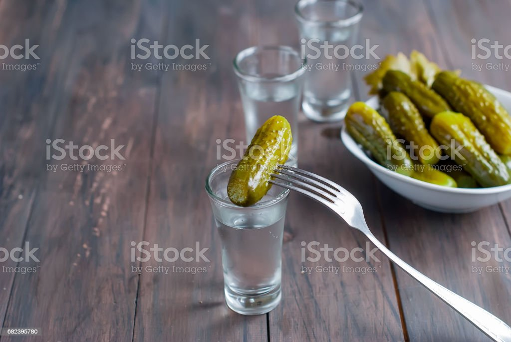 small glass with Russian vodka and salt cucumber royalty-free stock photo