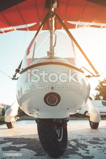 Small glider plane parked close up frontal view