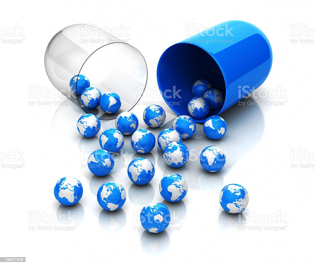 Small globes spilling out of an open pill capsule royalty-free stock photo