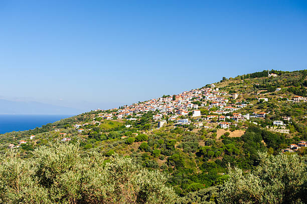 Small Glossa town on Skopelos Glossa Town on Skopelos, located above Loutraki  glossa stock pictures, royalty-free photos & images