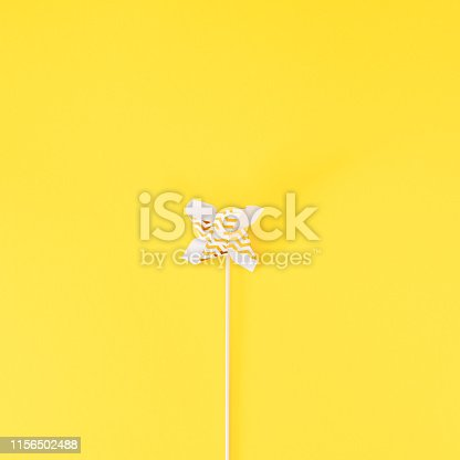 istock Small Golden Pinwheel toy fan 1156502488