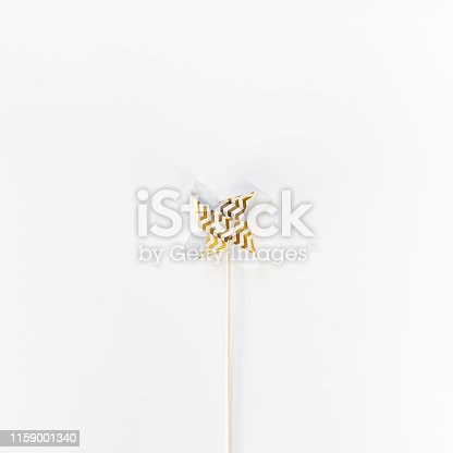 istock Small Golden Pinwheel toy fan 1159001340