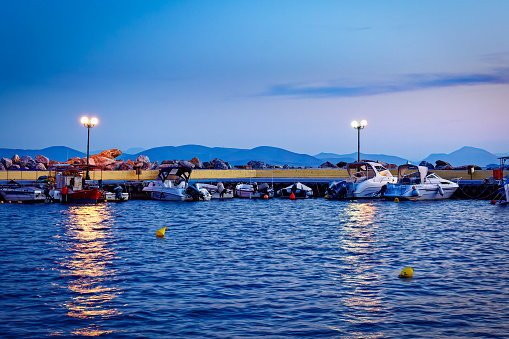 Small Greek harbour with boats in Pelion, night photo of marine harbour