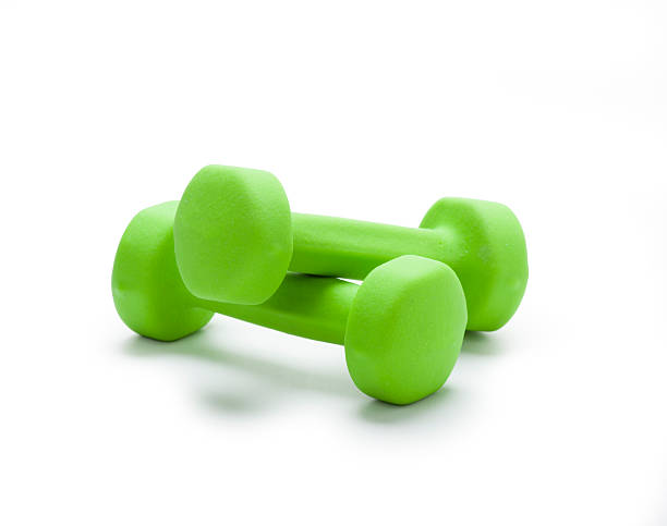 small green dumbbells,  isolated in white - weights stock photos and pictures