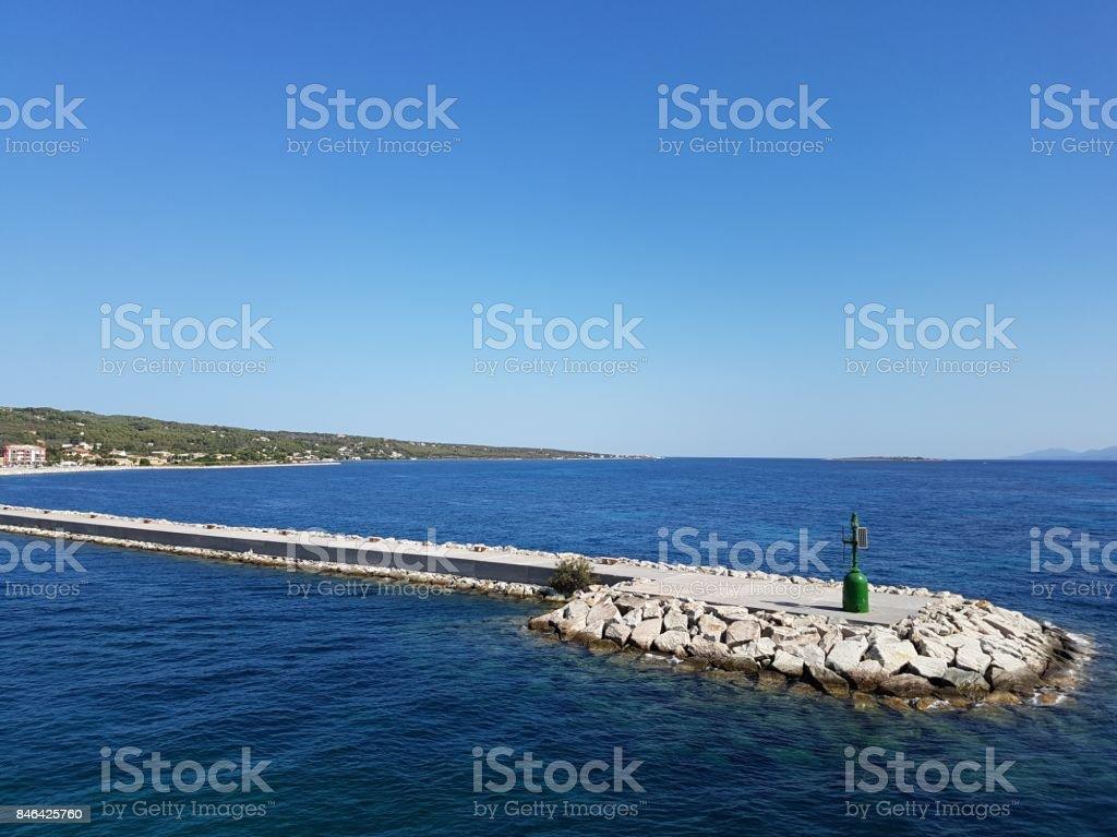 Small green lighthouse Carloforte, Sardinia Italy stock photo