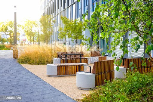 Small green square with benches in a modern urban space, Berlin, Germany