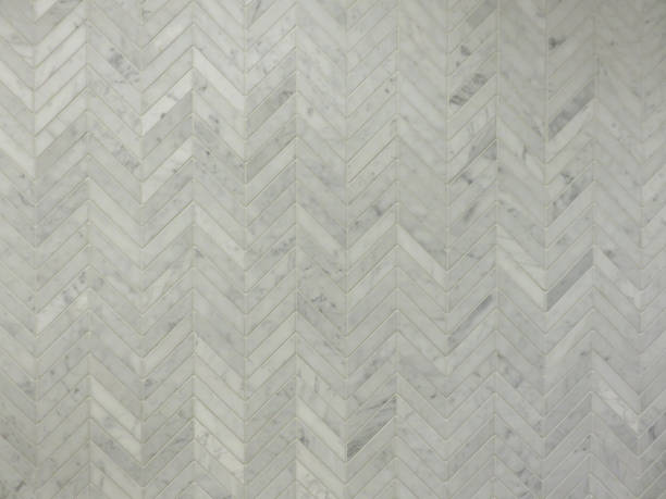 small grey chevron wall tile pattern - chevron stock photos and pictures