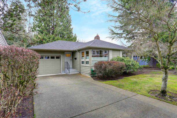 Small grey home exterior with a garage stock photo