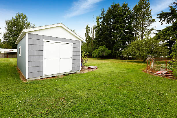 Small grey shed with white trim. Countryside real estate Countryside landscape with small grey and white shed shed stock pictures, royalty-free photos & images