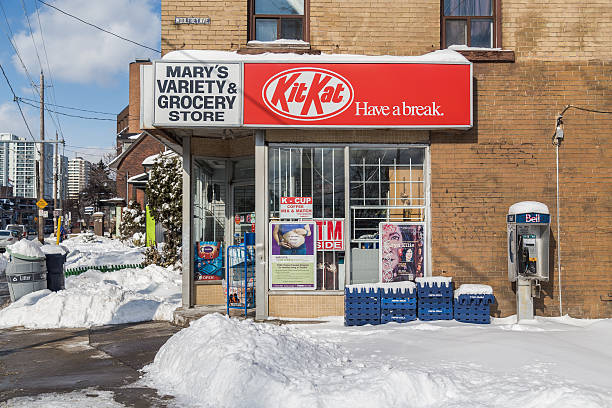 small grocery store in toronto in the winter - kit kat stock photos and pictures