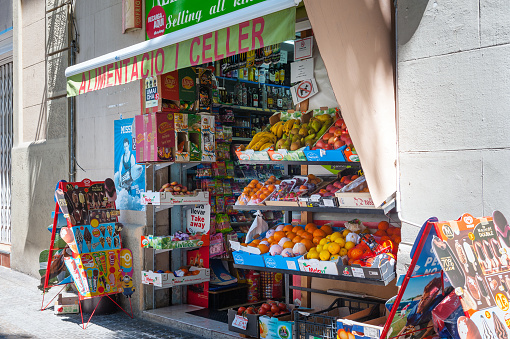 Small grocery store with fresh fruits and vegetables at street of Barcelona town.