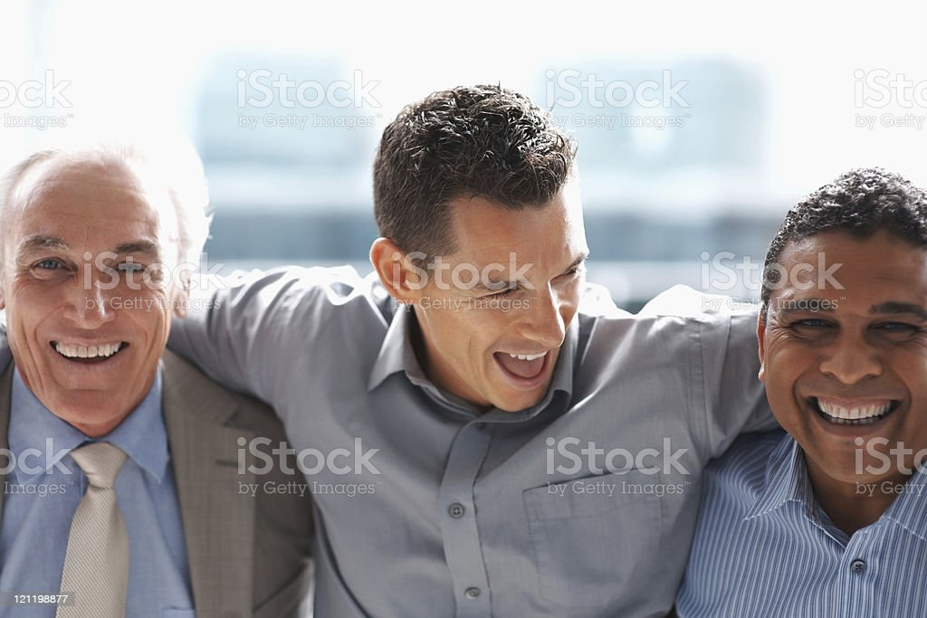 Small  group of business men smiling in an office royalty-free stock photo