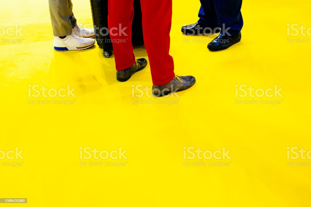 Small Group of Business Men Standing on a Yellow Carpet stock photo