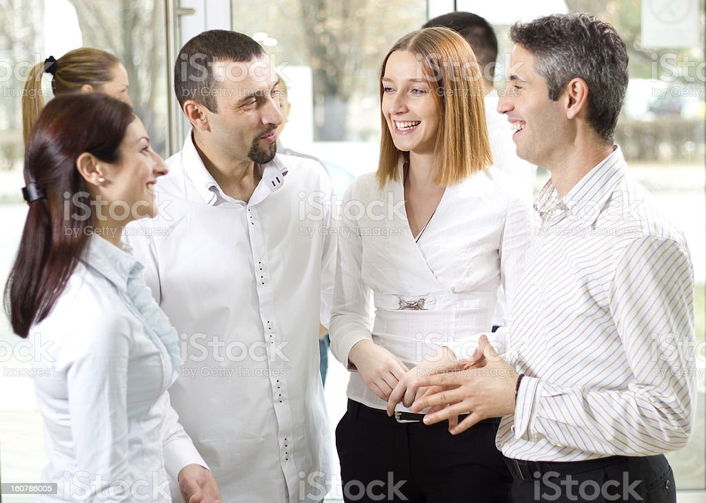 Small group of business people discussing royalty-free stock photo